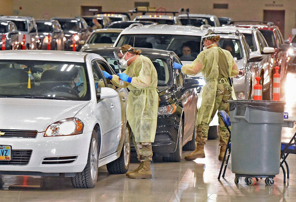 North Dakota National Guard soldiers administered coronavirus tests inside a civic center in Bismarck, N.D., the week before Thanksgiving.