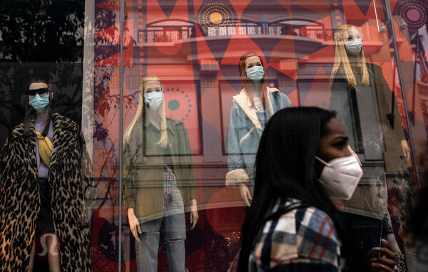 A shopper in Los Angeles, on Monday, where even the mannequins were wearing masks.