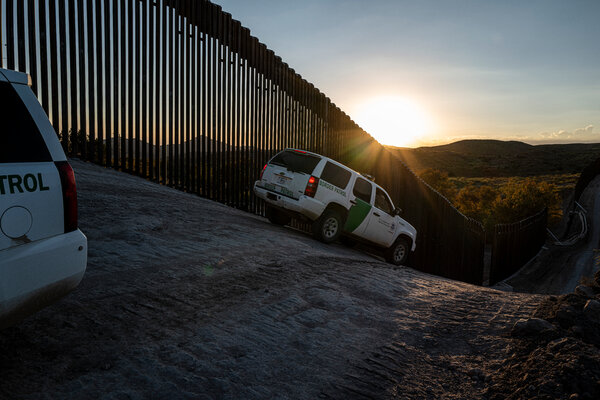 Border Patrol agents at a border wall section being built in the Guadalupe Canyon in Arizona.