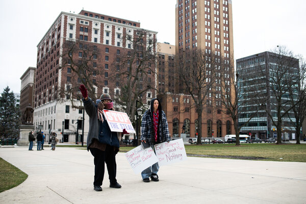 Protesters outside the State Capitol in Lansing, Mich., on Monday as the Electoral College prepared to cast its votes.