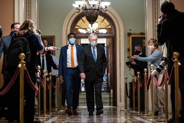"""Mitch McConnell, the Senate majority leader, in the U.S. Capitol on Tuesday. """"We committed to continuing these urgent discussions until there's an agreement,"""" he said Wednesday morning."""