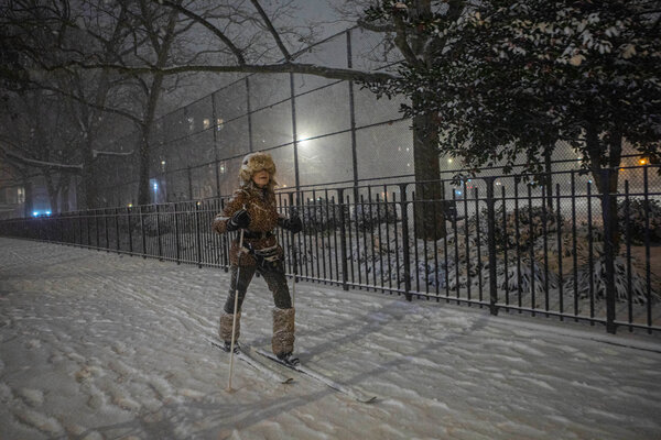 A woman skiing in the East Village in Manhattan on Wednesday night.