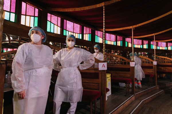 Medical workers prepare to administer coronavirus tests at a theater in Le Havre, France, on Monday. France is a member of Covax, an international group that has negotiated for vaccine doses, including for low- to middle-income countries.