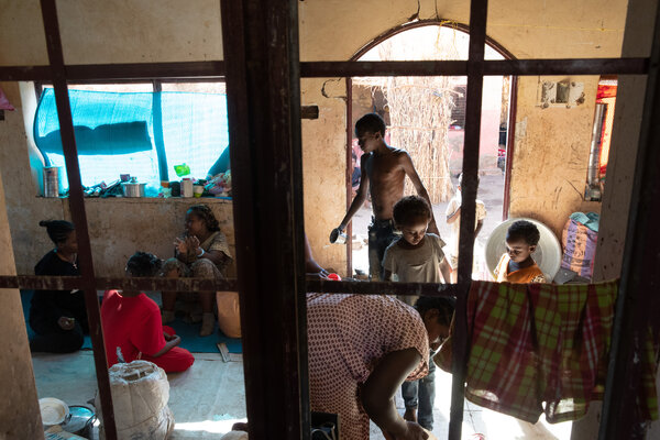 Refugees living in one of the only formal structures in the Um Rakuba camp in Sudan.
