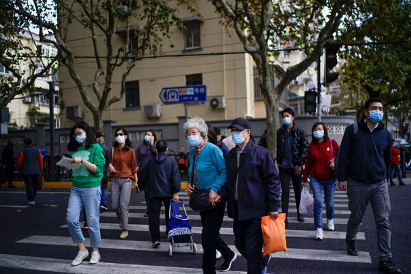 Pedestrians in Shanghai this week. Chinese cities respond to even a single coronavirus case with extensive testing programs.