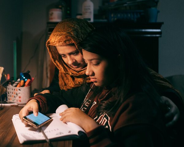 Taniya Ria, 12, is learning remotely, and her mother, Rokeya Khatun, tries to help.