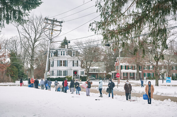 People lining up for a meal delivery from a food bank in Rochester, N.H., this month. The agreement by Congress on a stimulus package is a welcome relief, though some worry it might not be enough.