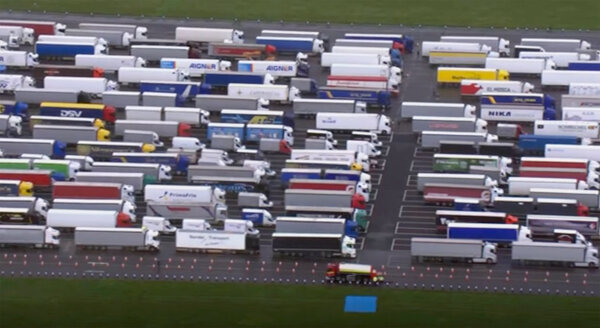 Trucks parked on a former airfield in southeast England that has been turned into a holding area while the border to France is closed.