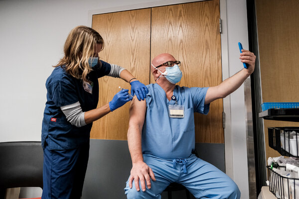 A health care worker at the Virginia Hospital Center in Arlington, Va., took a selfie of his vaccination.