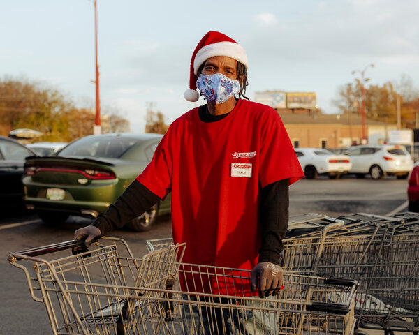 Tennessee has reported the country's most cases per 100,000 people on average over the last seven days. Gov. Bill Lee has refused to enforce a mask mandate, but an employee at a Memphis grocery store wears a mask as he hauls shopping carts.