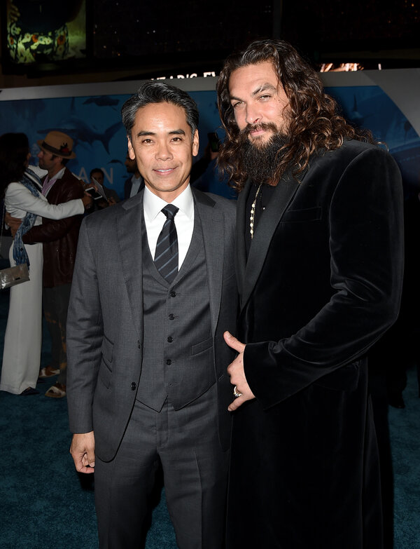 """Mr. Hamada and Jason Momoa, the star of """"Aquaman,"""" which was the lone superhero movie from Warner Bros. in 2018."""