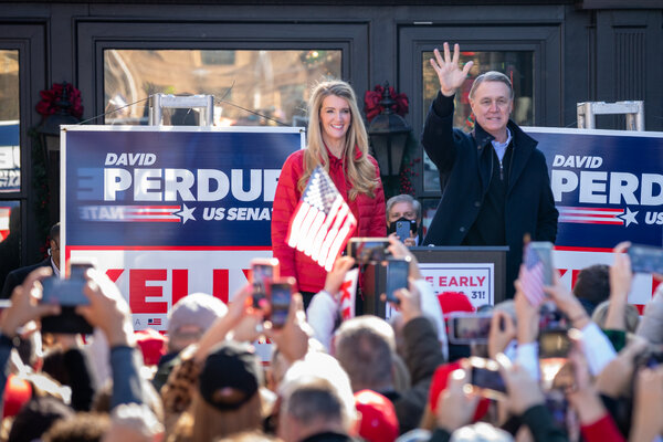 Senators Kelly Loeffler and David Perdue at a campaign event in Milton, Ga., this month. Both said they would support $2,000 stimulus payments on Tuesday.