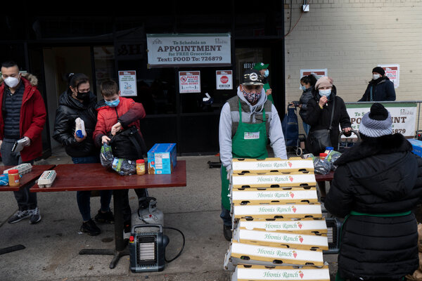People picked up free groceries at a food pantry in Queens, N.Y., on Monday.
