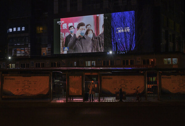 A newscast in Beijing, displaying President Xi Jinping's first visit to Wuhan in March.