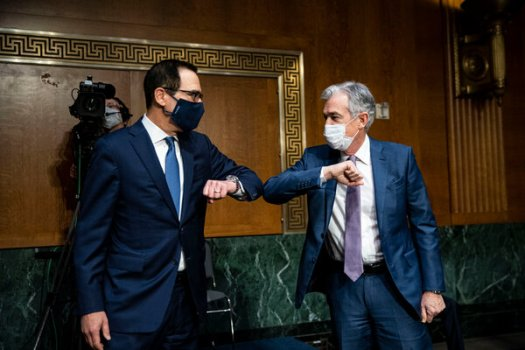 Treasury Secretary Steven T. Mnuchin and Fed Chair Jerome H. Powell bumped elbows before a Senate Banking Committee hearing on Tuesday.