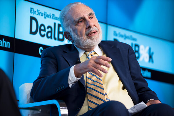 Carl Icahn at the DealBook Conference in 2015. By reducing his stake in Herbalife, the investor will also give up five board seatsheld by his designees.
