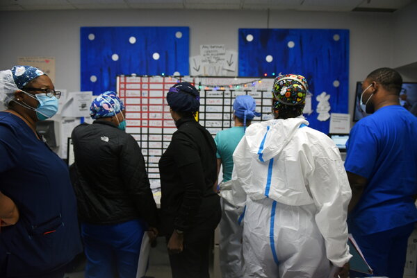 Nurses checked the nightly schedule at United Memorial Medical Center in Houston at the change of shifts in the Covid-19 care unit going into the first day of 2021.