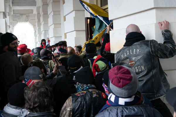 Members of the mob trying to break through one of the Capitol's exterior doors.