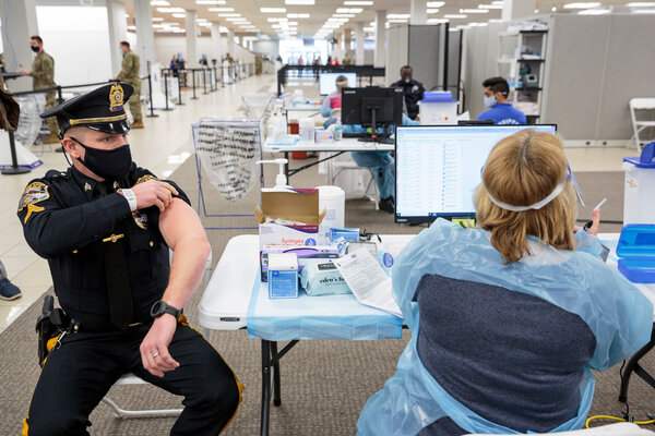 Michael Zarro, a police sergeant in Mount Olive, N.J., rolled up his sleeve for a coronavirus vaccination on Friday.