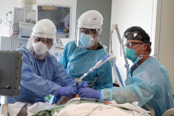 Doctors intubated a Covid-19 patient at a Mission Viejo, Calif., hospital on Friday.