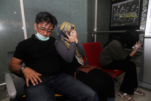 Relatives of passengers of missing Sriwijaya Air Flight 182 waiting for news at the Supadio Airport on Borneo island on Saturday.