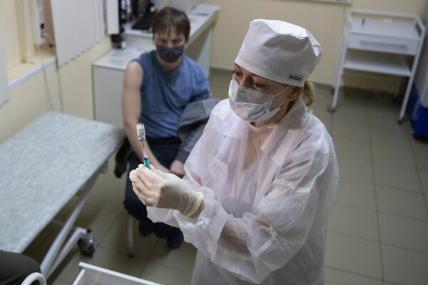 A medical worker preparing a dose of the Sputnik V vaccine in Moscow last month.