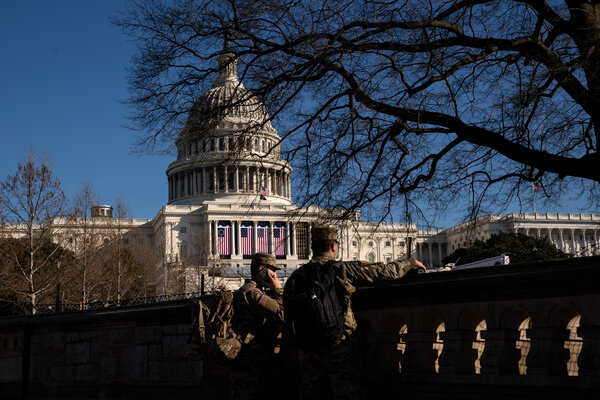 National Guard troops stationed outside the Capitol on Tuesday. Security has been ramped up since last week's riot.