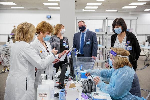 Health workers preparing vaccinations in Rockaway, N.J.
