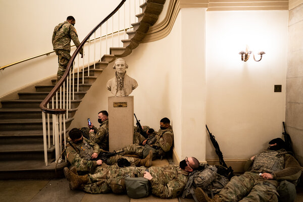 National Guard troops resting in the Capitol on Wednesday morning as the House prepared to debate the impeachment charge.