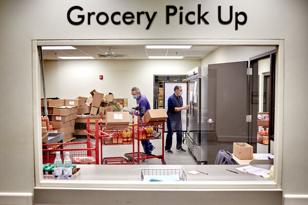 Volunteers process donations at a food pantry in Wichita, Kan. More than one million people filed new claims for unemployment benefits last week.