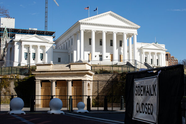 The State Capitol in Richmond, Va., and the square in front of the building were secured with fencing and boards on Friday.