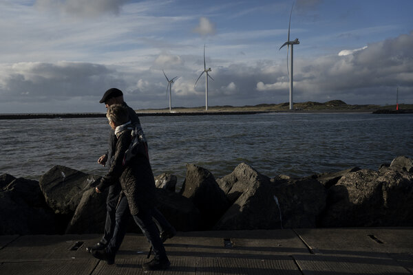 Windmills made by Vestas on the Danish coast.  Shares of renewable energy companies have gained momentum this week as President Biden recommended the Paris Climate Agreement to the United States.