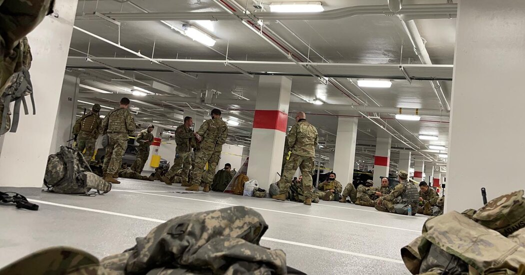 National Guard troops who protected the Capitol for Biden's Inauguration were told to sleep in a parking garage.
