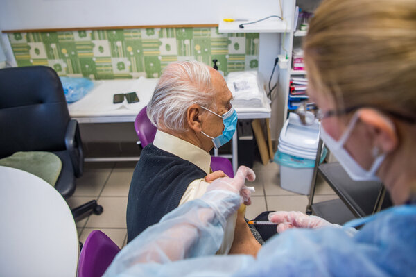 A nursing home resident receiving the Pfizer-BioNTech coronavirus vaccine in Budapest this month.