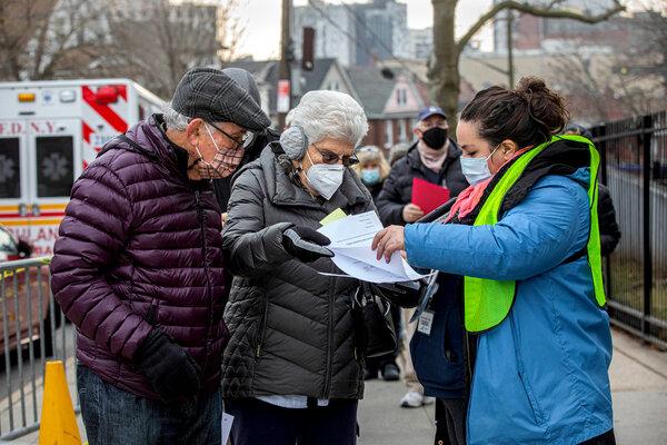 New Yorkers waited in line at vaccine hub in Queens last week.
