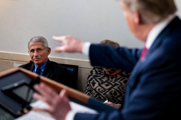 Dr. Anthony M. Fauci with President Donald Trump during the daily Coronavirus briefing in the White House briefing room in April.