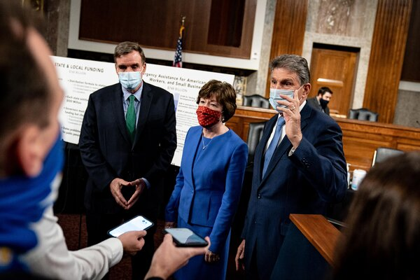 From left, Senators Mark Warner, Democrat of Virginia; Susan Collins, Republican of Maine; and Joe Manchin III, Democrat of West Virginia, speaking to reporters after a news conference to introduce a Covid relief bill at the Capitol on Dec. 14.