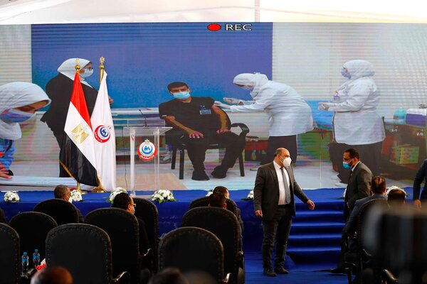 A large screen showed a nurse, Ahmed Hamdan Zayed, receiving the Chinese-made Sinopharm vaccine during a news conference at the Abou Khalifa hospital in Ismailia, Egypt, on Sunday.