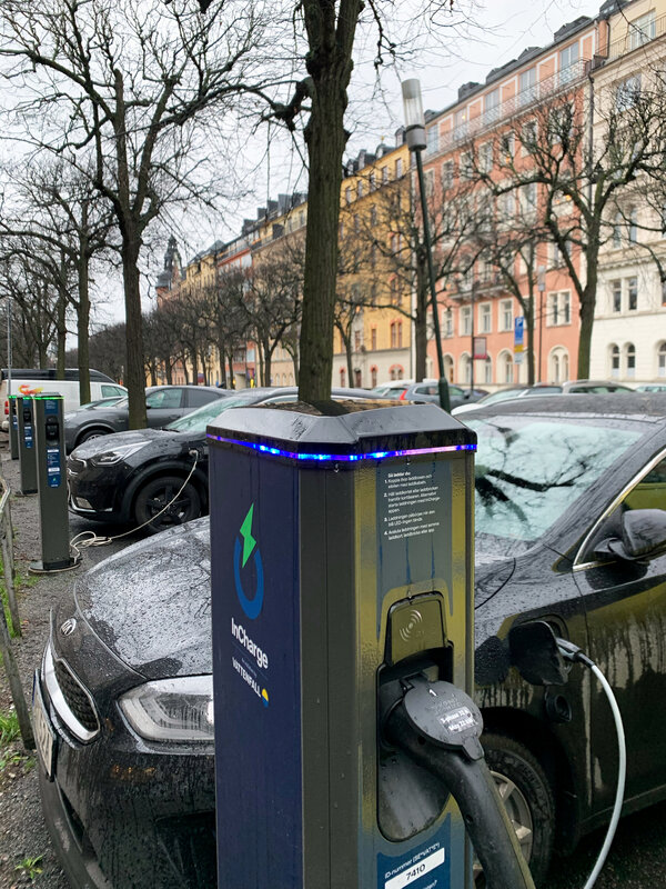 Electric cars plugged into charging stations in Stockholm. Several companies are getting into the battery business in Europe, including Tesla.