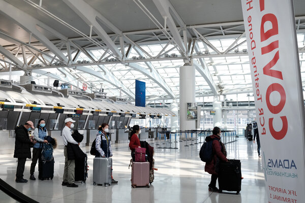 At Kennedy Airport in New York on Monday. Several countries are imposing restrictions on international air travelers, including the United States.