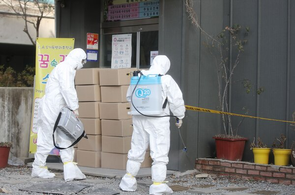 Disinfecting a missionary training school in Gwangju, South Korea, on Wednesday.Religious groups in South Korea have driven several coronavirus outbreaks.