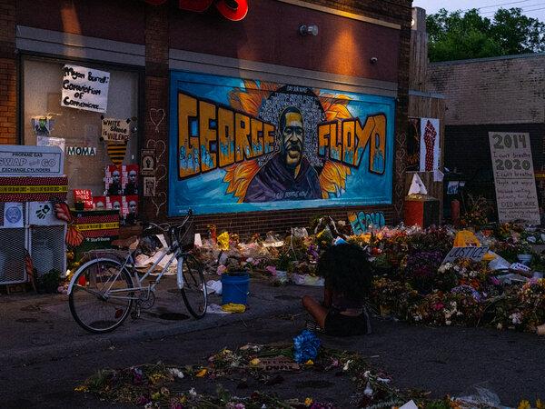 Community members visit the George Floyd memorial site in Minneapolis.