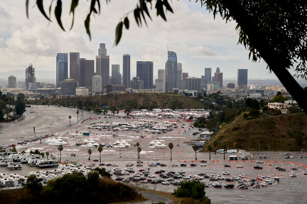 Cars lined up on Friday at a Covid-19 vaccination site at Dodger Stadium in Los Angeles.