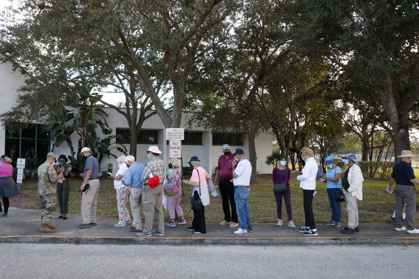 People waiting in line to be vaccinated at a library in Bonita Springs, Fla., on Tuesday.