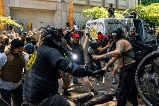 Far-right and far-left groups clashing in Portland, Ore., in August. Dozens of F.B.I. employees and senior managers were sent on temporary assignments there, according to current and former law enforcement officials.