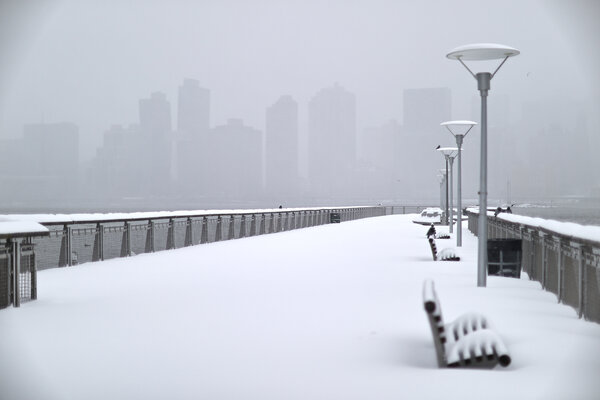 Gantry State Park in Long Island City, Queens, on Monday. A City Council election is proceeding on Tuesday despite the snowfall.