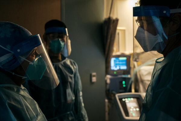 Gabriela Flores with Dr. Joseph Meltzer, a visiting U.C.L.A. physician explaining her husband's condition through a nurse interpreting.