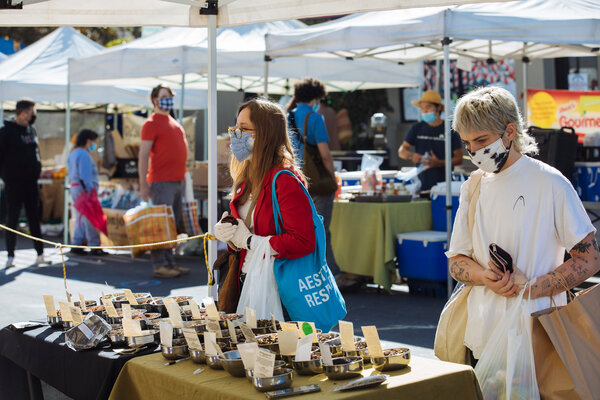 Shoppers at a farmers market in Los Angeles. A majority of Americans support direct stimulus checks.