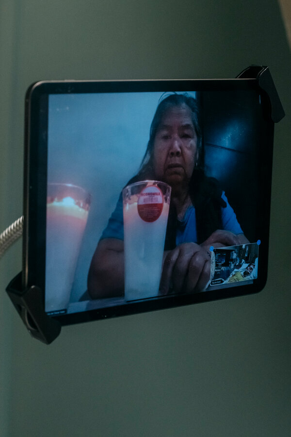 Maria Alcalan Magallon, Mr. Flores's mother, seeing her son on Zoom from Mexico.