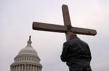 Supporters of President Donald J. Trump prayed outside the Capitol on Jan. 6.Some of the rioters that day were motivated by religious fervor.